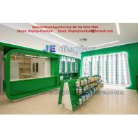 Cheap Health drugs Store Display Furniture for Interior Design by Green color Wood  Cabinet and Tempered Glass Shelves for sale