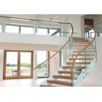 Cheap 40mm rubber wood curved stairs with tempered clear glass railing top railing for sale
