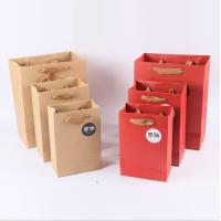 China Cardboard Paper Kraft Shopping Paper Bags With Handles Custom Logo Printed on sale