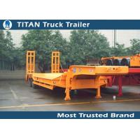 Cheap Economic 2 axles 30 tons semi Low Bed Trailer with heavdy duty steel spring ramps for sale