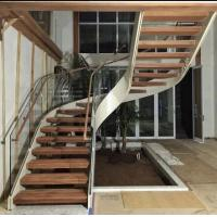 Cheap Indoor use wood step glass railing steel curved staircase for sale